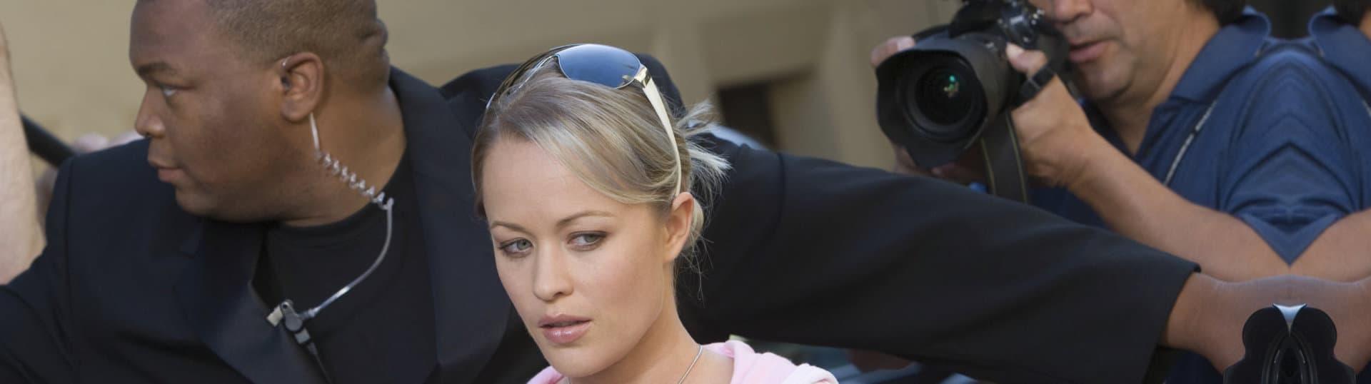 Closeup of a female celebrity and bodyguard